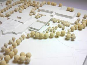 Das Siegermodell: Zwischen die Bestandsbauten fügt sich der Neubau der Grundschule mit der Mensa (Bildmitte) ein. Foto:  Stadt Münster.