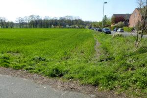 Auf der Fläche zwischen der Straße Im Moorhock und dem Rektoratsweg soll ein neues Wohnquartier mit rund 60 Wohneinheiten entstehen. Foto: Stadt Münster.